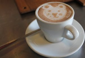 Espresso with foam shaped like bear face