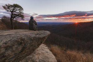 hiker watching sunrise